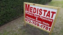 An advertising sign stands outside the offices of Medistat Group Associates in DeSoto, Texas, on Tuesday, Feb. 28, 2012. Dr. Jacques Roy, who ran the business, and six other associates were arrested and charged with recruiting homeless people, among others, as part of a $375 million home health care fraud scheme, authorities announced Tuesday. (Michael Ainsworth/Michael Ainsworth/The Dallas Morning News/Associated Press)
