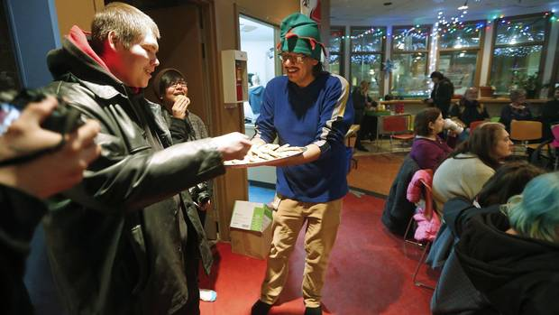 Tony Niiganii, coordinator for the North End Youth Council and facilitator for the North End Youth Skills Development Strategy, hands out cookies baked by youth in his program.