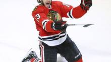 Chicago Blackhawks' Daniel Carcillo celebrates scoring the game winning goal against the Colorado Avalanche during the third period of their NHL hockey game in Chicago, Illinois, March 6, 2013. (JIM YOUNG/REUTERS)