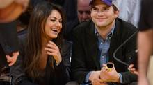 Actors Mila Kunis and Ashton Kutcher at a Los Angeles Lakers game in Los Angeles, January 4, 2014 (Noel Vasquez/Associated Press/AP)