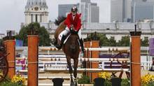 "Canadian rider Tiffany Foster, on her horse Victor, competes in the qualifying round of the equestrian jumping event at the London 2012 Olympic Games August 4, 2012. Foster was disqualified before the team show jumping final on August 5, 2012 because of hypersensitivity in her horse's front leg, a decision team captain Eric Lamaze called ""a complete miscarriage of justice"". Picture taken August 4, 2012. (MIKE HUTCHINGS/REUTERS)"