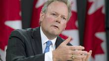 Governor of the Bank of Canada, Stephen Poloz speaks with media during a news conference Thursday June 12, 2014 in Ottawa. (Adrian Wyld/The Canadian Press)