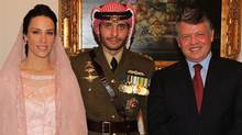 Princess Basmah al Hussein, formerly Basmah Hasan of Stratford, Ont., left, and groom Prince Hamzah al Hussein of Jordan are seen with Jordan's King Abdullah II. (The Canadian Press/The Canadian Press)