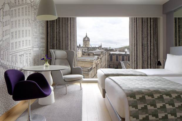 Edinburgh's city skyline and a line drawing by Jim Hamilton of Graven Images lend character to a Superior Room at the G&V Royal Mile Hotel Edinburgh.