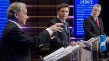 Raymond Bachand, left, speaks as Pierre Moreau, centre, and Philippe Couillard look on during their English language PLQ leaders debate in Montreal Saturday, January 26, 2013. (Graham Hughes/The Canadian Press)
