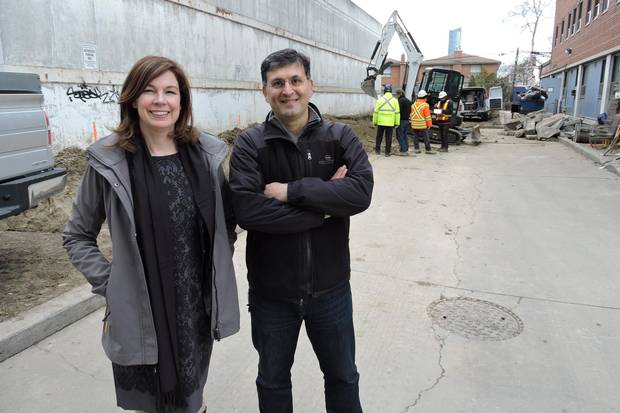 St. Clare's operations manager Andrea Adams, left, and physical assets manager Mohammad Anvari pose at 25 Leonard Ave., where excavation has begun for a three-storey building that will provide purpose-built rentals for homeless people.