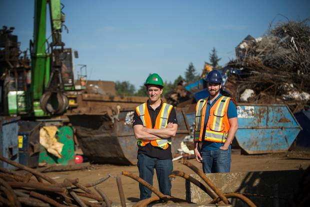 Face-to-face interaction is key in the global scrap-metal recycling business, despite communications and other technologies.With David Yochlowitz, left, is Mike Yochlowitz, vice-president of operations.