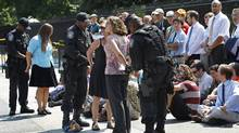 U.S. Park Police officers handcuff and arrest protestors over a proposed pipeline to bring tar sands oil to the U.S. from Canada, in front of the White House in Washington, Saturday, Aug. 20, 2011. (Manuel Balce Ceneta/Manuel Balce Ceneta/Associated Press)