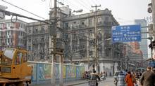 Overhead wires obscure neoclassical and art deco buildings in the Bund neighbourhood. (Anna Greenspan for The Globe and Mail)
