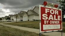 A for sale sign stands in front of a home in Lee's Summit, Mo. in this file photo. (Charlie Riedel/AP)