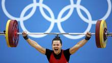 Canada's Christine Girard competes on the women's 63Kg weightlifting competition at the ExCel venue at the London 2012 Olympic Games July 31, 2012 (Reuters)