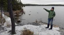 Diane Orihel, a scientist and founding director of the Coalition to Save ELA, is photographed beside one of the many lakes in the Experimental Lakes Area on Nov. 1. (Fred Lum/The Globe and Mail)