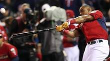 American League's Yoenis Cespedes, of the Oakland Athletics, hits during the MLB All-Star baseball Home Run Derby, Monday, July 14, 2014, in Minneapolis. (Jim Mone/AP)