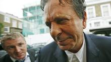 Art collector Charles Saatchi is questioned by reporters as he arrives at his home in west London June 18, 2013. Saatchi has been cautioned by police for assaulting his wife, the celebrity chef Nigella Lawson, after being photographed grabbing her by the throat in an incident that has fueled a debate in Britain about domestic violence. (OLIVIA HARRIS/REUTERS)