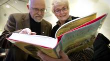 "Howard White, president of Harbour Publishing looks over the newly released ""The Chuck Davis History of Metropolitan Vancouver"" with Chuck Davis' wife Edna at the book launch in Vancouver November 17, 2011. (JOHN LEHMANN/The Globe and Mail)"