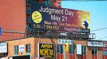 The U.S.-based evangelical group Family Radio has bought 2,000 ads around the world, including this one on Yonge Street in Toronto, warning of the end of the world. (Kevin Van Paassen/The Globe and Mail/Kevin Van Paassen/The Globe and Mail)