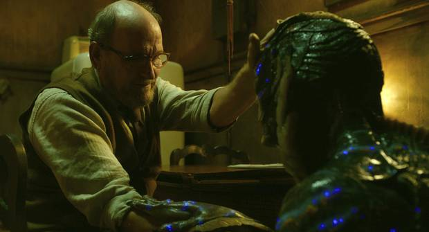 Richard Jenkins, left, and Doug Jones in a scene from the film The Shape of Water. Toronto-based firm SideFx produced many of the stunning images for it.