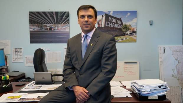 Steve Buckley, Toronto's general manager of transportation services, sits on his desk in Toronto city hall.