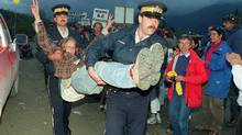 An anti-logging protestor is carried away by RCMP after being arrested for blocking Macmillan Bloedel logging trucks at the entrance to Clayoquot Valley on July 30, 1993. It is the quiet amid the chaos just as the logging trucks and police rolled in that Tzeporah Berman remembers acutely about the War in the Woods, the fight by environmentalists 20 years ago over Clayoquot Sound that the now-seasoned campaigner says set the stage for today's battles over pipelines and other resource development issues. (Chuck Stoody/THE CANADIAN PRESS)