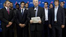 Donald Fehr (centre) Executive Director of the NHLPA stands with NHL players as they speak with the press following collective bargaining talks in Toronto on Tuesday August 14, 2012. (Chris Young/THE CANADIAN PRESS)