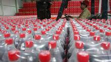 File photo of a Coca-Cola bottling plant. (AHMAD MASOOD/REUTERS)