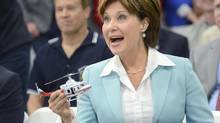 B.C. Premier Christy Clark receives a toy helicopter after touring Alpine Aerotech during a launch celebration in West Kelowna on Sept. 27, 2013. She says her province is moving closer to an agreement with Alberta that would lay a path for oil sands bitumen to reach her province's ports. (Gary Nylander/The Canadian Press)
