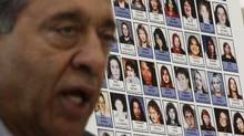 Photographs of missing women are displayed as Commissioner Wally Oppal speaks in Vancouver, January 19, 2011. (Darryl Dyck/ The Canadian Press/Darryl Dyck/ The Canadian Press)
