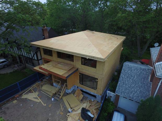 The low-slope roof delivers on modernist look the owners want while costing far less than a completely flat roof.