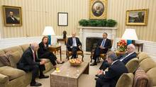 In a White House handout photo, President Barack Obama and Vice President Joe Biden meet with Israeli and Palestinian negotiators to discuss the formal resumption of direct Israeli-Palestinian negotiations in the Oval Office of the White House, July 30, 2013. Secretary of State John Kerry said on Tuesday that Israeli and Palestinian negotiators would convene again in the Middle East within two weeks. From left: Yitzhak Molho, Israeli Justice Minister Tzipi Livni, Biden, Obama, Palestinian Chief Negotiator Saeb Erekat and Mohammad Shtayyeh. (CHUCK KENNEDY/NYT)