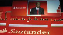 Emilio Botin, chairman of Santander Bank, is projected on a screen as he speaks during the annual general meeting of the bank in Santander March 30, 2012. (STRINGER/SPAIN/Reuters)