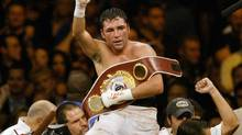 FILE - In this June 5, 2004 file photo, Oscar De La Hoya celebrates his unanimous decision victory over Germany's Felix Sturm following their WBO world middleweight title fight in Las Vegas. (JOE CAVARETTA/AP)