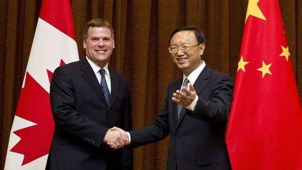 Foreign Minister John Baird, left, is greeted by his Chinese counterpart Yang Jiechi during his visit to China's Foreign Ministry office in Beijing, China, Monday, July 18, 2011.