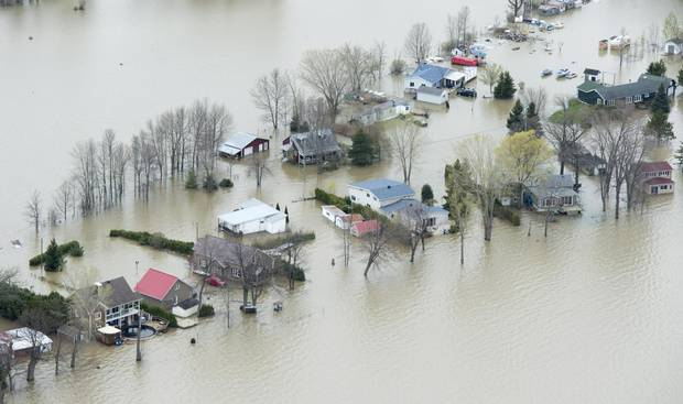 Flooded homes are seen on Monday, May 8, 2017 in Rigaud, Que., west of Montreal.