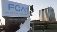 A new Fiat Chrysler Automobiles sign is unveiled at Chrysler Group World Headquarters in Auburn Hills, Mich., May 6, 2014. (REBECCA COOK/REUTERS)
