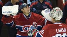 Montreal Canadiens' goaltender Carey Price, left, talks with fellow goaltender Nathan Lawson during second period pre-season NHL hockey action against the Dallas Stars in Montreal Tuesday, Sept. 20, 2011. (Graham Hughes)