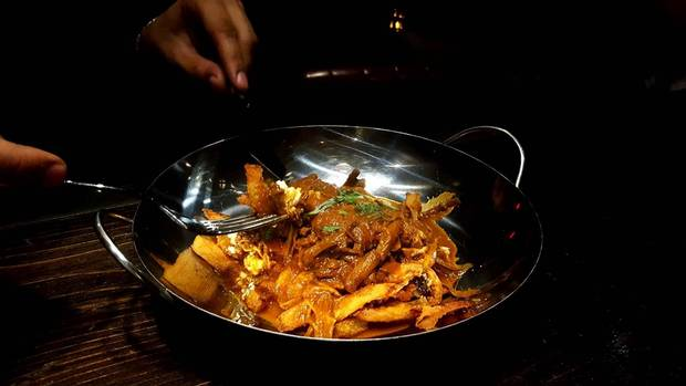 If you're looking for Indian street food on a budget, try the curried brisket poutine at Ji, at St. Clair Avenue West and Christie.