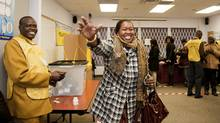 Kitchener woman Roda William Gany, 30, celebrates after casting her vote for the Southern Sudan referendum. Voters flock to a polling station in North York, Jan. 9, 2010 to cast their ballots for a referendum in Southern Sudan on whether or not the region should remain a part of Sudan. (Sarah Dea for The Globe and Mail/Sarah Dea for The Globe and Mail)