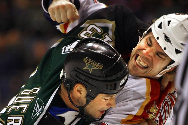 Dec. 7, 2005: Steve Montador, right, then of the Florida Panthers, fights with Bill Guerin of the Dallas Stars.