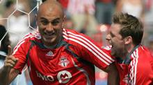 Toronto FCAndy Welsh (right) celebrates Danny Dichio's goal in the ninth minute against the Colorado Rapids during MLS soccer action in Toronto Saturday, June 2, 2007. (CP PHOTO/Adrian Wyld) (Adrian Wyld/CP)