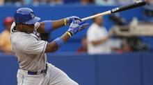 Los Angeles Dodgers Yasiel Puig hits an RBI single against theToronto Blue Jays during the second inning of their MLB interleague baseball game in Toronto, July 22, 2013. (MARK BLINCH/REUTERS)