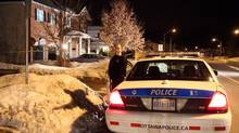 An Ottawa police car sits outside the scene of an investigation into three deaths in Stittsville, a suburb of Ottawa, on Monday, January 14, 2013. (PATRICK DOYLE/THE CANADIAN PRESS)