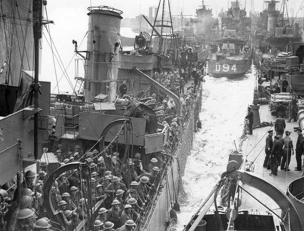 After a successful emergency sealift from a beachhead at Nazi-occupied Dunkirk, France, British and French soldiers arrive safely at an unknown British port, in June 1940.