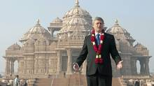 Prime Minister Stephen Harper stands infront of the BAPS Swaminarayan Akshardham temple in New Delhi on Wednesday, November 18, 2009. (Adrian Wyld)