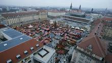 "A general overview shows the so-called ""Striezelmarkt"" Christmas market in the eastern German town of Dresden, December 20, 2012. German consumer morale dropped for the fourth month running to its lowest level in more than a year as shoppers become increasingly wary of the effect the euro zone debt crisis is having on Europe's largest economy. Picture taken December 20, 2012. (Tobias Schwarz/Reuters)"