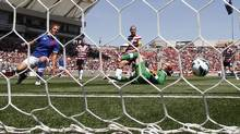 Midfielder Carmelina Moscato (L) of Canada knocks the ball past her own own goalkeeper Erin McLeod (18) for a U.S. goal during the first half of their international women's friendly soccer match in Salt Lake City, Utah, June 30, 2012. (JIM URQUHART/REUTERS)