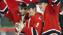 Team Canada's Patrice Bergeron, left, Sidney Crosby, center, and Corey Perry celebrate after defeating Russia 6-1 to win the gold medal at the World Junior Hockey Championships in Grand Forks, N.D., in this Jan. 4, 2005 file photo. (RYAN REMIORZ/Canadian Press)