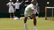 Switzerland's Roger Federer returns the ball during a training session at the All England Lawn Tennis Club before the start of the London 2012 Olympic Games in London on Wednesday. (STEFAN WERMUTH/REUTERS)