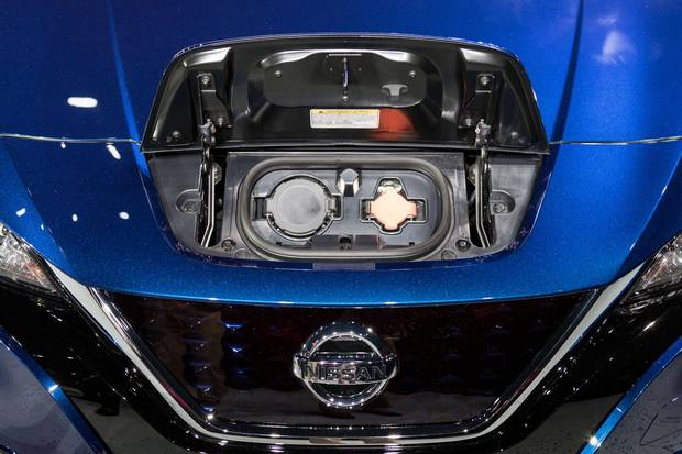 The charging port is located above the Leaf's front grille.