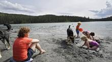 Dawn Lammer watches her children Thomas and Tori and friend Lucy Baxter play on the beach at Long Lake in Whitehorse, Yukon on Thursday June 20. (Photo by Ian Stewart) (Ian Stewart)