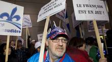 Pro-French language protesters rally outside the Bell Centre in Montreal, Saturday, January 7, 2012, during a demonstration denouncing the recent appointment of a unilingual head coach of the Montreal Canadiens hockey team. CANADIAN PRESS/Graham Hughes (Graham Hughes/CP)